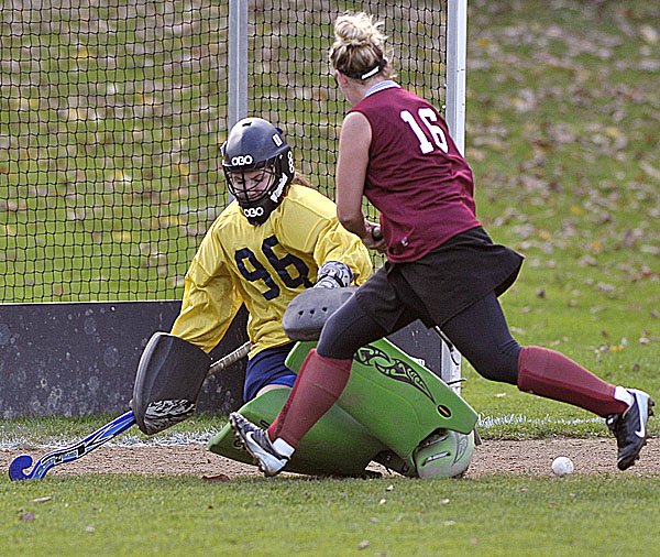 Belfsat goalie Julia Ward makes a kick save on a shot by Foxcroft Academy's Tia Tondreau (16) in the second half of regulation play in their game in Belfast Tuesday, Oct. 18, 2011.