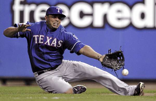 Right fielder Nelson Cruz of the Texas Rangers stretches in vain to grab a soft liner by Allen Craig of the St. Louis Cardinals during the sixth inning of Game 1 of the World Series on Wednesday night. Craig's RBI single gave the Cards a 3-2 victory.