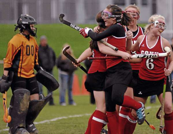 Cony High School of Augusta's Kaitlyn Labbe jumps into the arms of teammate Heather Leet, who scored late in the second half to give the Rams a 1-0 win over Brewer in their Eastern Maine Class A quarterfinal at Heddericg Field in Brewer. Alyssa Brochu (6) shares in the jubilation while Brewer goalie Casey White looks on in the background.