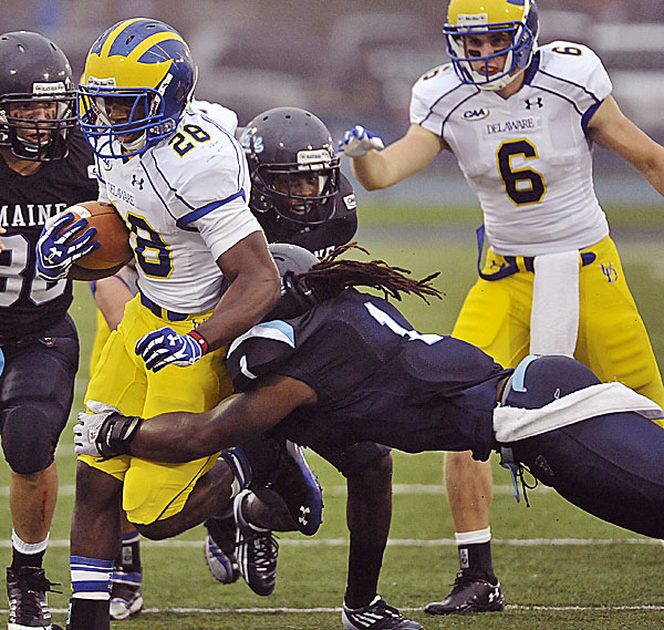 Maine's Jerron McMillian makes a flying tackle on Delaware's David Hayes during their game in Orono on Oct. 1. McMillian has helped lead Maine to a 5-1 start entering Saturday's game at Richmond.