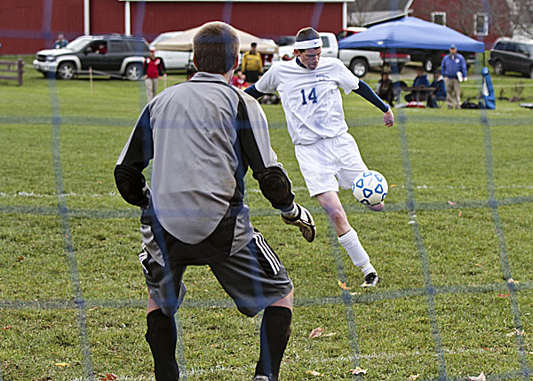 Washburn's Mitch Worcester buries a shot into the back of the net  past Fort Fairfield Tiger goalie Chris Weeks in the first half of an Eastern Maine Class D prelim held in Washburn Friday. Washburn won 7-0.