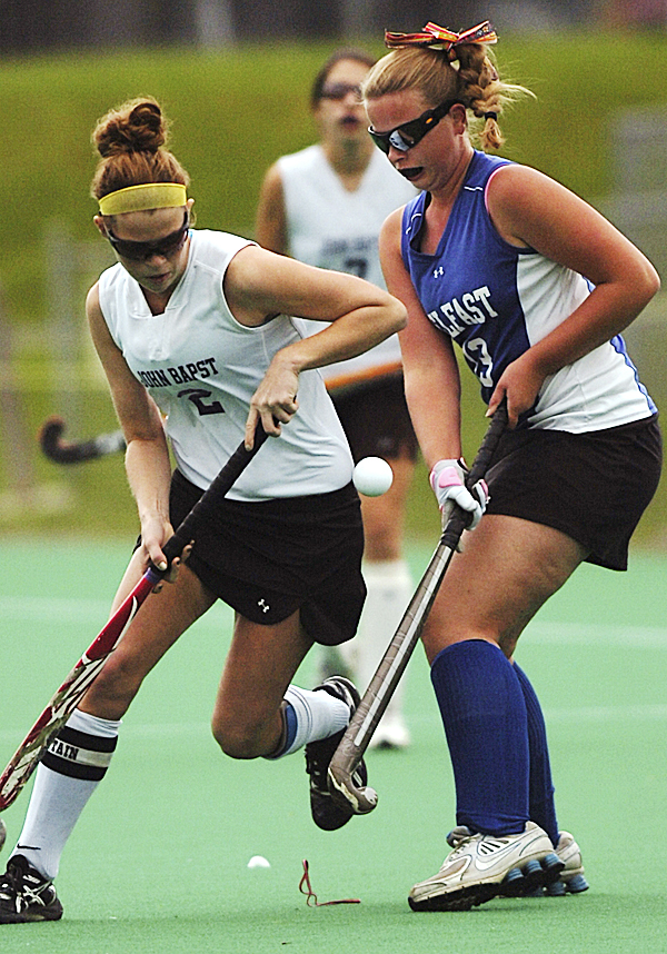 Belfast's Kristi Osgood, right, looks to gain control of the ball from John Bapst's Emily Tilton, left, during Saturday's Eastern Maine Class B semifinal field hockey game at the University of Maine in Orono. Belfast won 3-2. Osgood and twin sister Kari will lead Belfast against Nokomis in the regional final at Hampden Academy Tuesday at 7:30 p.m.