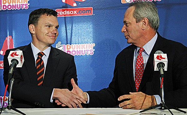Boston Red Sox new general manager Ben Cherington shakes hands with team president Larry Lucchino during a news conference at Fenway Park in Boston, Tuesday, Oct. 25, 2011.