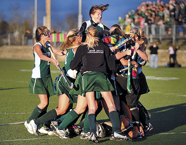 The Winthrop High School girls celebrate their 1-0 victory over Dexter High School in Tuesday afternoon's Eastern Maine Class C field hockey championship in Hampden.