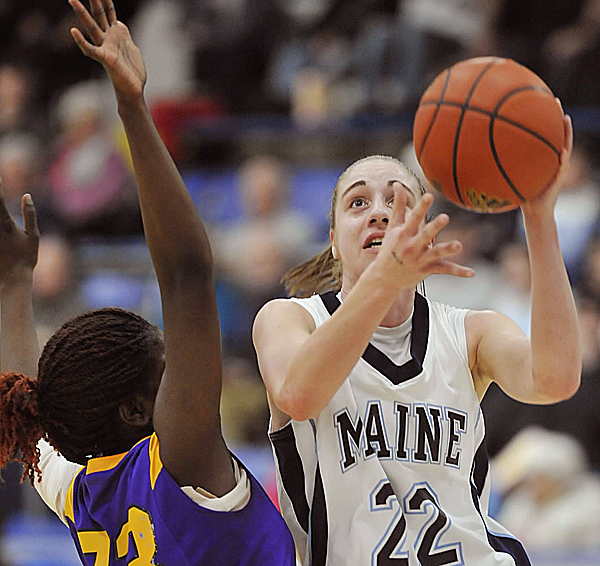 Maine's Samantha Wheeler drives around Albany's Tabitha Makopondo during a game last season. Wheeler has spent the last 11 months dealing with the after-effects of a concussion. She had been doing some on-court workouts with the team this preseason, but recently was forced to curtail her efforts.