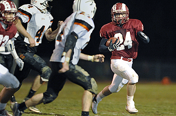 Bangor's Zeb Tuell, right, sweeps around the Skowhegan defense in the second quarter Friday night at Cameron Stadium in Bangor.