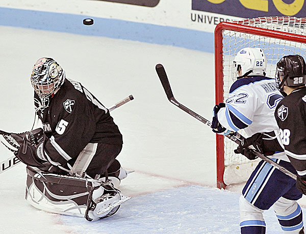 Providence College defenseman Steven Shamanski (28) tries to keep Maine center Stu Higgins (22) off a rebound that bounced over Providence goalie Alex Beaudry (35) in the first period of their game in Oorno Friday Oct. 28, 2011.