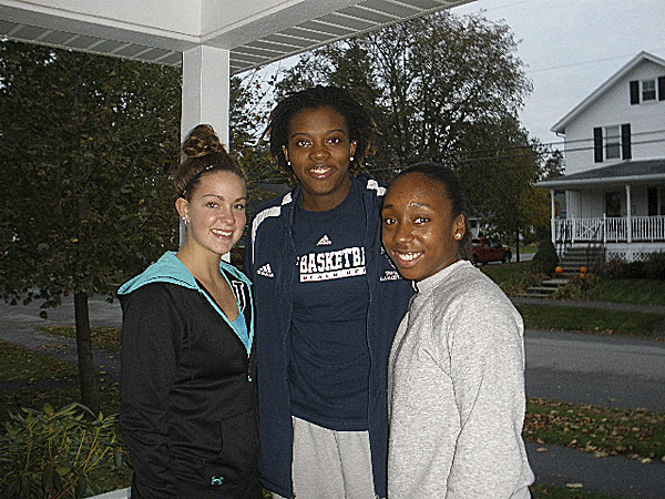 University of Maine women's basketball players (from left) Kelsey Mattice, Shareka Maner and Amber Dillon pose for a photo after delivering season tickets to the Bangor home of Ralph White and Joni Averill last Saturday. The Black Bears passed out sets of tickets to many UMaine fans.