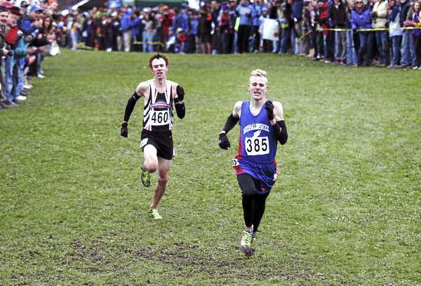 Harlow Ladd (right), of Messalonskee High School leads Nick Morris, of Scarborough High School as they run Saturday, Oct. 29, 2011 during the Class A State Cross Country Championships at Twin Brooks Recreation Area in Cumberland, Maine. Morris came back to beat Ladd by .02 seconds with a time of 16:46.81.