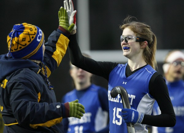 Belfast's Brooklyn Curry (15) is congratulated after scoring the game-winning goal in her team's field hockey state championship victory over York in Yarmouth on Saturday, Oct. 29, 2011.