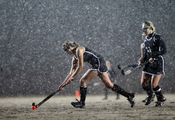 Skowhegan's Nicole Seevey takes a shot in the snow storm in her team's defeat of Marshwood in the snow for the state championship, in Yarmouth on Saturday, Oct. 29, 2011.