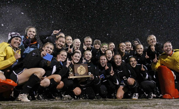 Skowhegan players pose with the trophy after their team defeated Marshwood in the snow for the field hockey state championship, in Yarmouth on Saturday, Oct. 29, 2011.