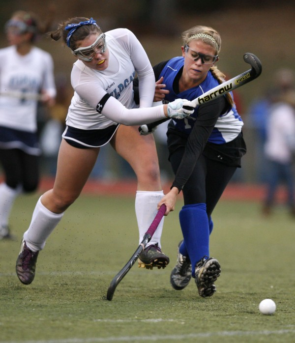 Belfast's Brittany Mellor (right) defends York's Elizabeth Fiorentino in the field hockey state championship game in Yarmouth on Saturday, Oct. 29, 2011. Mellor scored her team's first goal.