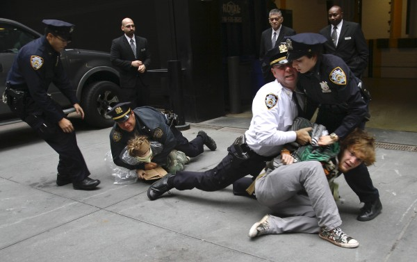 Police arrest marchers from Zuccotti Park's Occupy Wall Street, during a protest near One Chase Manhattan Plaza on Wednesday in New York. The protest is now in its fourth week.