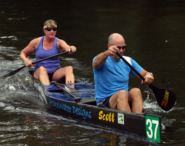 Sue Kerry and Scott Carroll from Saline, Mich., compete in a sprint race that will decide positions on the starting grid for the 120-mile Au Sable River Canoe Marathon. The non-stop race in Grayling, Mich., started at 9 p.m. July 30 and the first boats pulled into the finish about noon the next day.