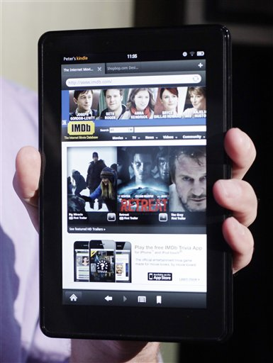 This Sept. 28, 2011 file photo, shows the Kindle Fire at a news conference, in New York. Retailers hope the Kindle Fire's low price tag - which is less than half that of Apple's cheapest iPad tablet - will attract shoppers to stores during the busy holiday season. But the device, which offers free shipping and other incentives for customers to shop at Amazon, ultimately could drive sales to their online nemesis. (AP Photo/Mark Lennihan, File)
