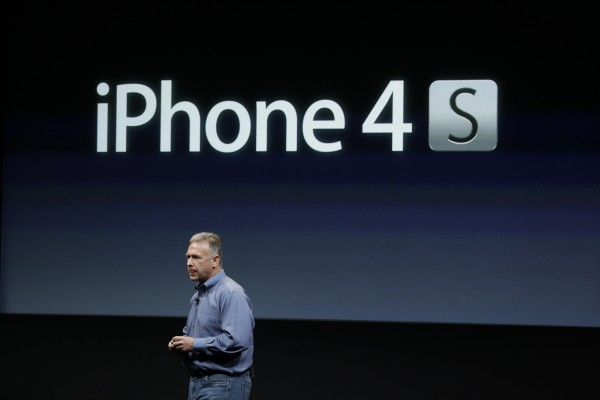 Apple's Phil Schiller talks about the iPhone 4S during an announcement at Apple headquarters in Cupertino, Calif., Tuesday, Oct. 4, 2011.