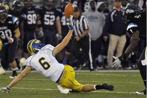 Delaware's Mark Schenauer (6) can't make a catch under pressure from Maine's Jerron McMillian (1) in the fourth quarter of an NCAA college football game in Orono, Maine, on Saturday, Oct. 1, 2011.