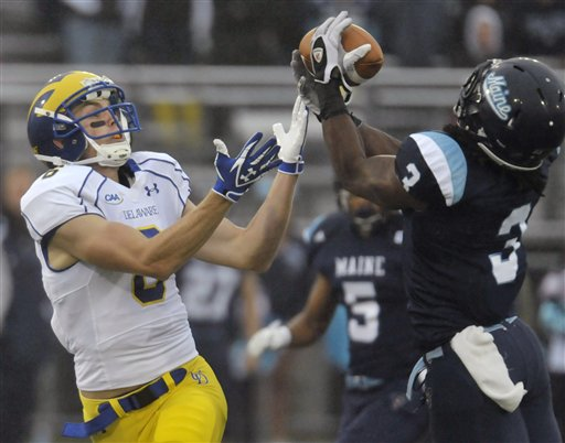 Maine's Trevor Coston (3) intercepts a pass intended for Delaware's Mark Schenauer (6) in the first quarter of an NCAA football game in Orono, Maine, Saturday, Oct. 1, 2011.