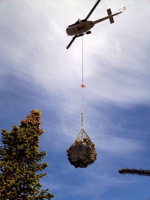 """A Maine Forest Service UH-1 """"Huey""""  helicopter and Helitack crew was used to slingload the remaining parts of the fire detection tower off Big Moose Mountain in Greenville. <<Big Moose Mtn Fire Tower 11 Oct 11.   <> <<Big Moose Mtn tower 11"""