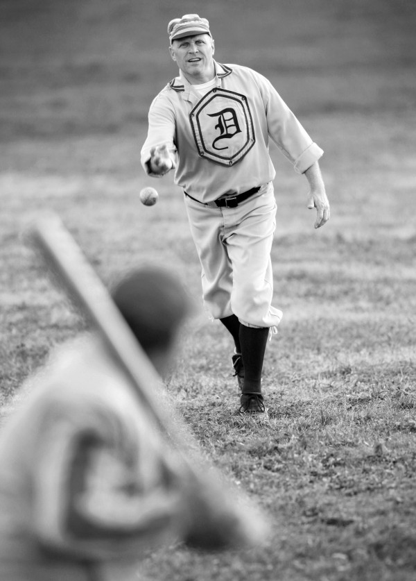 Dirigo player Kevin Sullivan pitches underhand during a recent game of vintage base ball in New Gloucester.