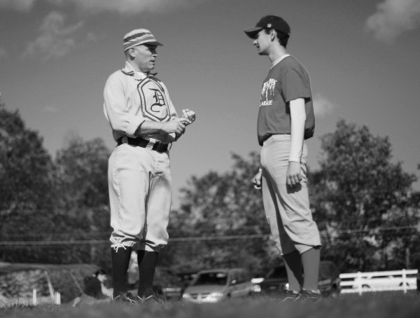 Dirigo player Kevin Sullivan (left) goes over the rules of 1861 base ball with opponent Tyler Credit, a sophomore at New Gloucester High School.