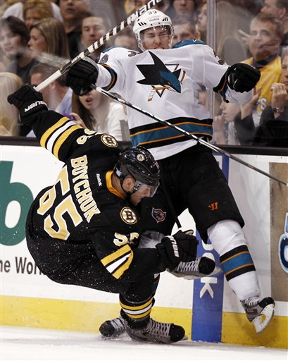 San Jose Sharks' Logan Couture collides with Boston Bruins' Johnny Boychuk (55) during the third period of San Jose's 4-2 win in a NHL hockey game in Boston Saturday, Oct. 22, 2011.