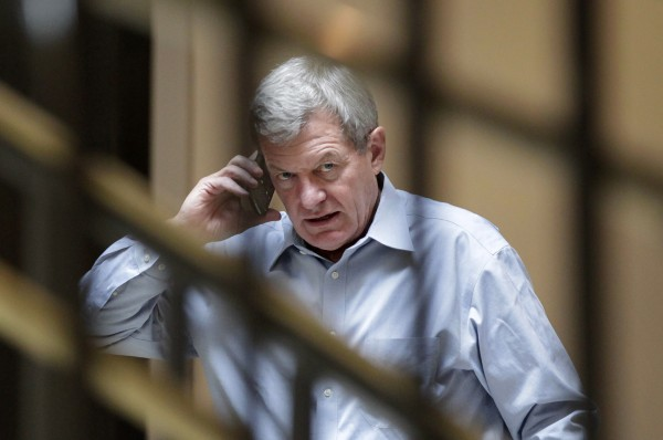 Sen. Max Baucus talks on his cell phone.