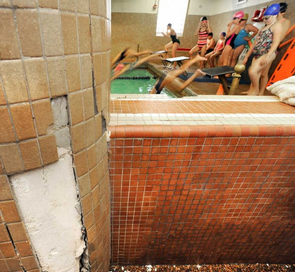 Swimmers are jammed in like sardines in the pool area, which shows its age at the Auburn YMCA.