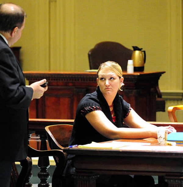 Lisa Levesque looks to her lawyer, Guy Loranger, before the jury entered the courtroom at Androscoggin County Superior Court on Thursday for closing arguments in her civil trial against the county. Levesque, a former Androscoggin County Jail guard, alleges administrators retaliated against her because of her opposition to the proposed return of her former supervisor to a day shift.