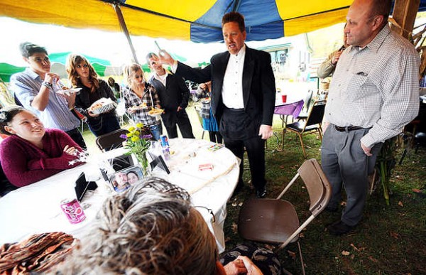 Steve Cornish of Lewiston entertains wedding guests with magic tricks during a lull in the festivities recently in Lewiston. Cornish, whom calls himself &quotThe Great Stephan,&quot claims to be one of the few wedding DJ and magician combos in the state of Maine.