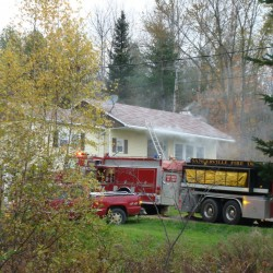 Sangerville firefighters were assisted by several surrounding fire departments at a house fire on French's Mills Road in Sangerville late Tuesday afternoon.