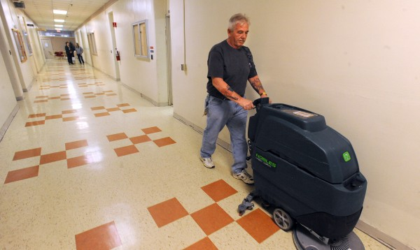 Jeff Welch cleans the floor in the office wing at the Dorothea Dix Psychiatric Center in Bangor in March.