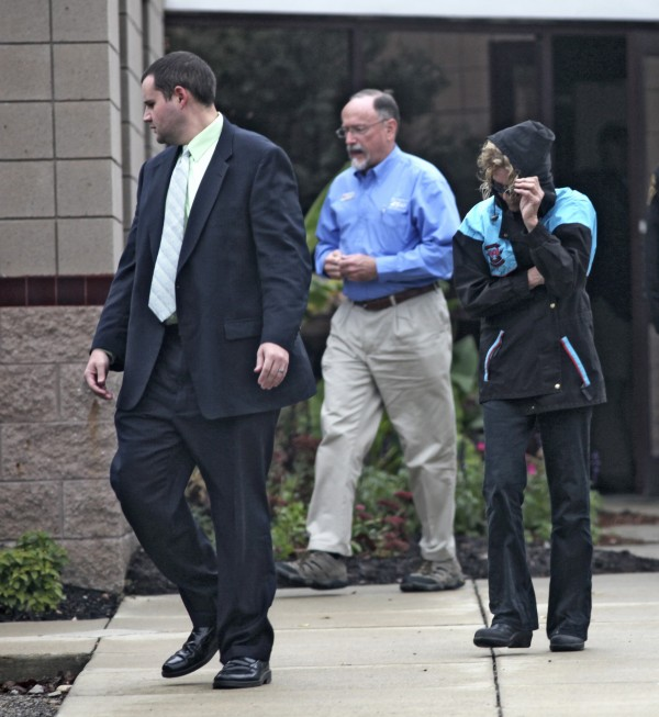 Marian Thompson (right) leaves the Columbus Zoo on Thursday, Oct. 27, 2011. The state Department of Agriculture intervened as she was about to retrieve animals being kept under quarantine at the zoo.