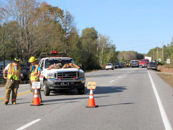 Jay firefighters assist at the scene of a crash on Route 4 in Jay on Friday afternoon.
