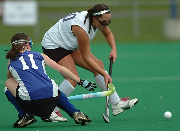 Belfast's Makaila Gould (left) and John Bapst's Lauren Prue (right) struggle for control of the ball during the first half of Saturday's Eastern Maine Class B semifinal field hockey game at the University of Maine in Orono.