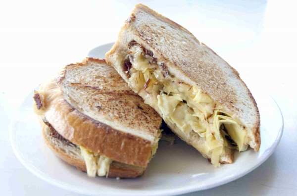 The gooey smoked gouda and artichoke heart on grilled sourdough is a creative take on the classic grilled cheese sandwich.
