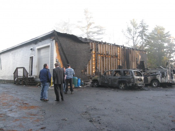 Burned-out vehicles line the rear of Bob Miles & Son Inc., today at 1162 Route 1 in Freeport. The business burned overnight Monday. Firefighters from six communities responded to the blaze, reported just before midnight today.