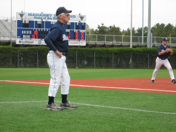 Skip Gordon of St. Albans follows the action as he coaches third base Sunday during the University of Maine Baseball Fantasy Camp at Mahaney Diamond in Orono. The cagy veteran helped his team post a 3-1 record during the weekend event.