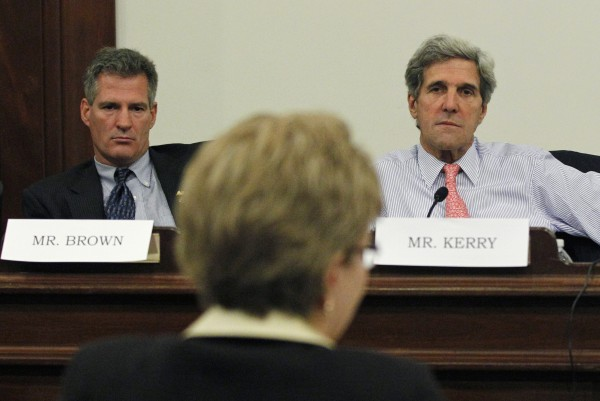 U.S. Sens. Scott Brown (left), R-Mass., and John Kerry, D-Mass., listen to Jane Lubchenco, head of the National Oceanic and Atmospheric Administration, during a hearing at the Statehouse in Boston on Monday, Oct. 3, 2011, regarding the state of the Massachusetts fishing industry.