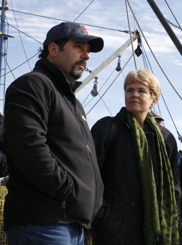 Fisherman Al Cottone, left, talks with NOAA Administrator Dr. Jane Lubchenco on the waterfront in in Gloucester, Mass., Tuesday, March 2, 2010.