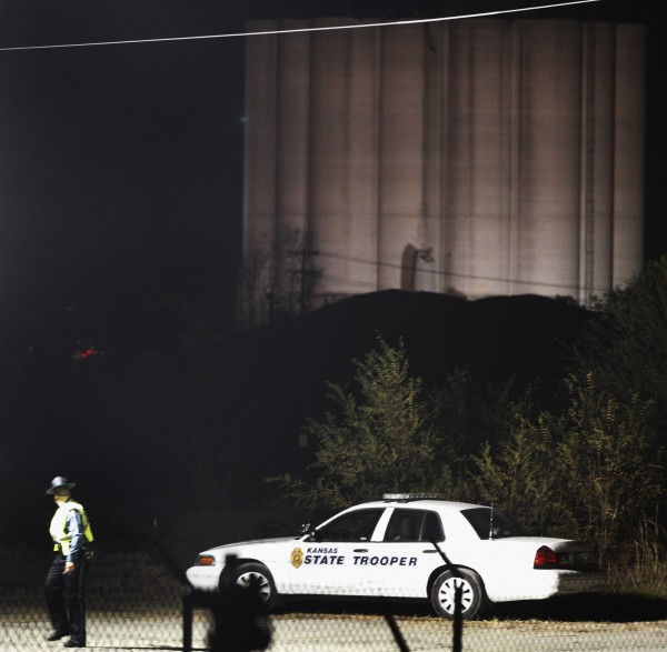 A Kansas State Trooper walks from his vehicle at the Bartlett Grain Co. elevator in Atchison, Kan., Saturday, Oct. 29, 2011.