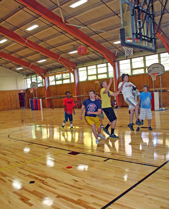 Several youngsters enjoy the new gymnasium floor at the Gentle Memorial Building in Houlton, which opened for the season on Oct. 11, 2011.