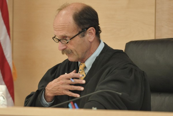 Superior Court Justice William R. Anderson asks defendant Horst Wolk (not pictured) several procedural questions before imposing a 10-year sentence on Wolk at Penobscot Judical Center on Wednesday, Oct. 5, 2011.