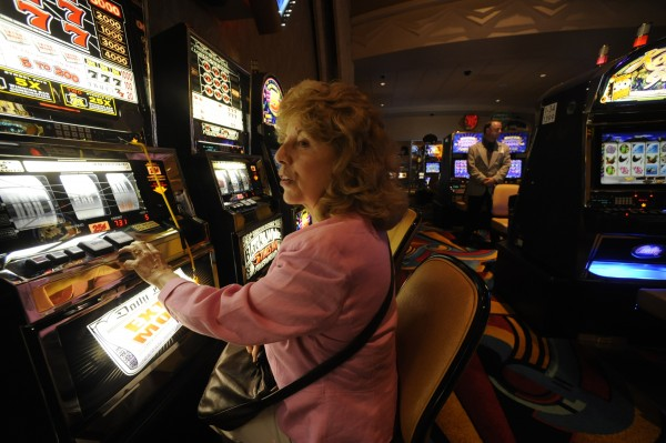 Elizabeth Milliken of Old Orchard Beach looks toward her husband who was playing a nearby slot machine at Hollywood Slots in Bangor in 2009.