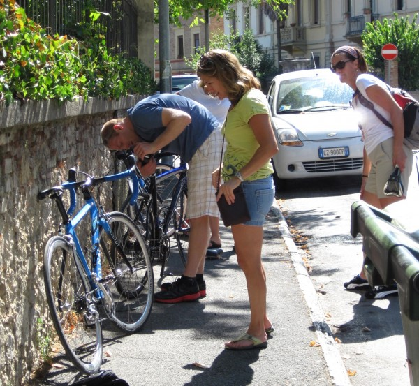 Dave Chamberlain (left) prepares rented bicycles for Christine Chasse (center) and Lise Collins for five days of cycling through Tuscany.
