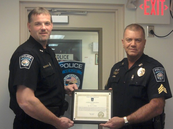 During a Veazie Town Council meeting on Tuesday, Oct. 11, Veazie Police Chief Mark Leonard (left) recognized Sgt. Paul Haslam for saving the life of a State Street resident who had attempted suicide on Aug. 24.