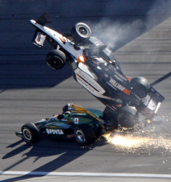 Dan Wheldon (77) goes airborne during a wreck that involved 15 cars in the IndyCar Series' Las Vegas Indy 300 auto race at Las Vegas Motor Speedway in Las Vegas on Sunday, Oct. 16, 2011. Wheldon died following the crash.