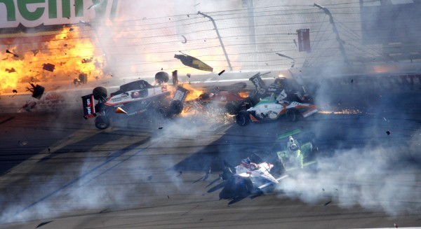 Drivers, including Will Power (12), of Australia, crash during a wreck that involved 15 cars during the IndyCar Series Las Vegas Indy 300 auto race at Las Vegas Motor Speedway in Las Vegas on Sunday, Oct. 16, 2011. Dan Wheldon died following the crash.