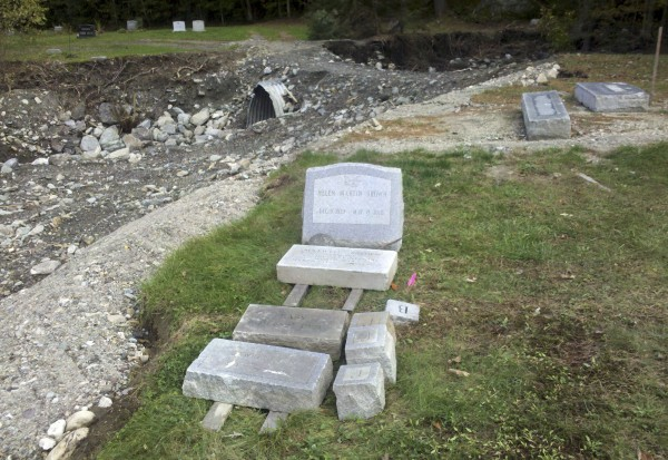 Recovered tombstones that were uprooted when raging floodwaters from the Nason Brook, fueled by Tropical Storm Irene, carved away part of the Woodlawn Cemetery in Rochester, Vt., are shown recently.